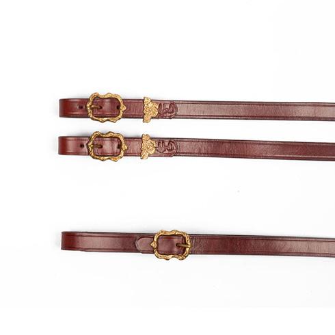 Zügel im barocken Stil aus braunem Leder mit goldenen Cortesia Schnallen bei Picadera